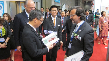 Giving an example of FDI publication Oral Health Atlas to Singapore Ministry of Health.