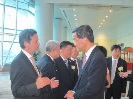 With Leung Chun-ying, Hong Kong prime minister.